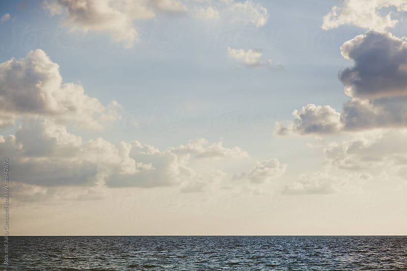 Morning clouds over the Caribbean Sea by Rob and Julia Campbell for Stocksy United