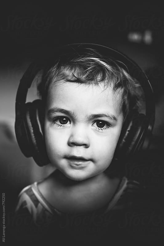 Toddler wearing headphones by Ali Lanenga for Stocksy United