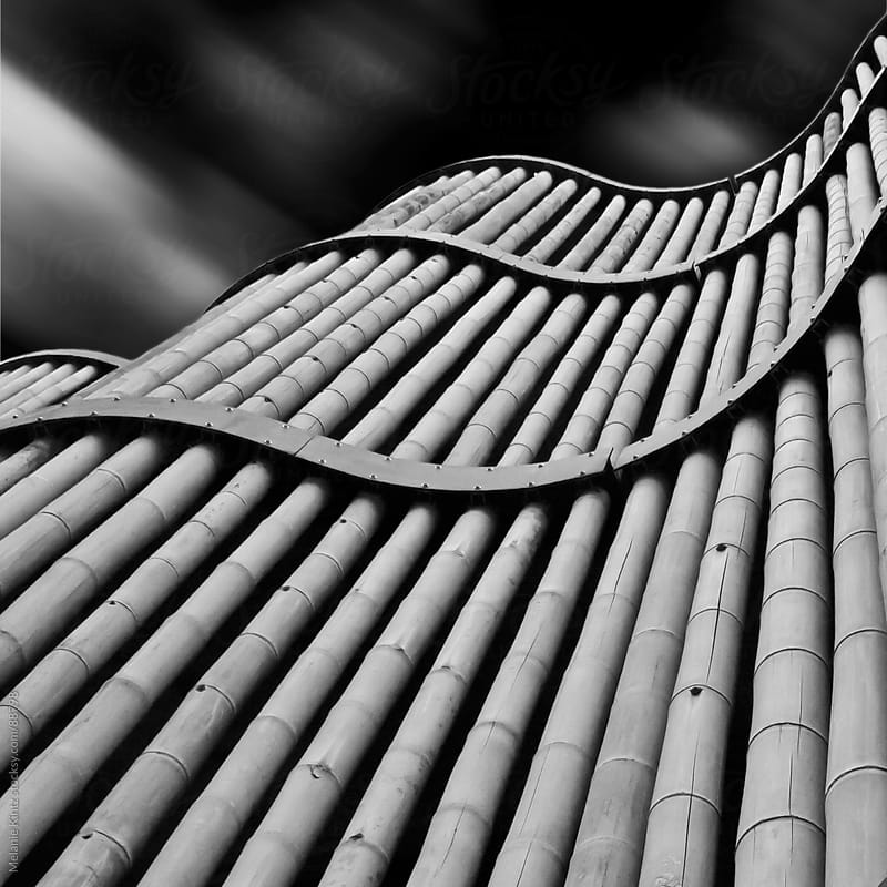 curved bamboo facade and sky by Melanie Kintz for Stocksy United