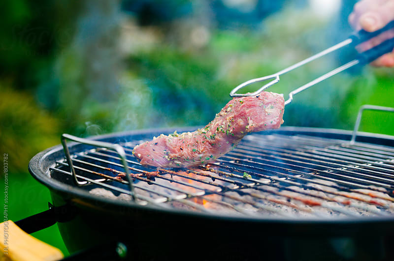 Grilled lamb fillet on the barbecue by J.R. PHOTOGRAPHY for Stocksy United