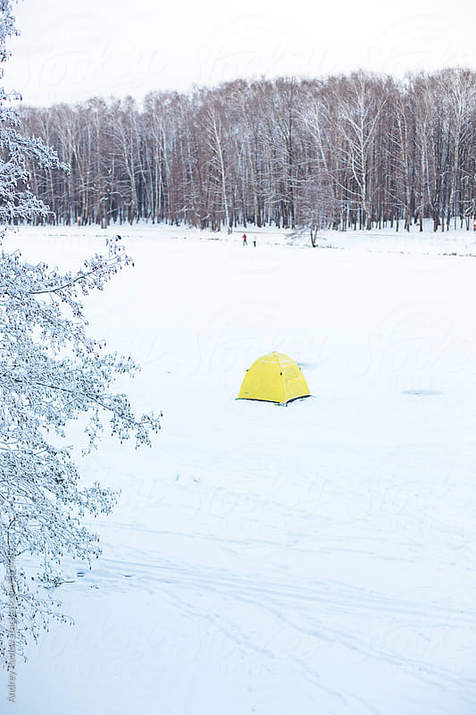Camping on iced river by Andrey Pavlov for Stocksy United