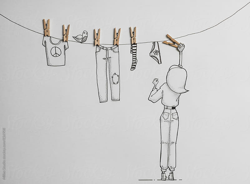 Girl hanging laundry by Milles Studio for Stocksy United