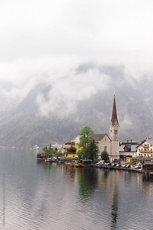 Foggy morning in Austrian village at mountain lake by Andrey Pavlov for Stocksy United