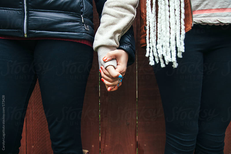 Mother and daughter holding hands by Carolyn Lagattuta for Stocksy United
