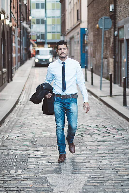 Businessman walking in an alley by Good Vibrations Images for Stocksy United