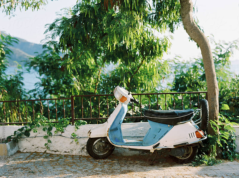 Moped under a tree in Kalkan, Turkey by Kirstin Mckee for Stocksy United
