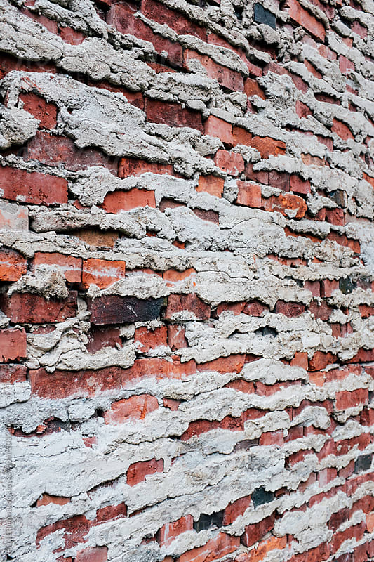 Detail of old brick wall by Paul Edmondson for Stocksy United