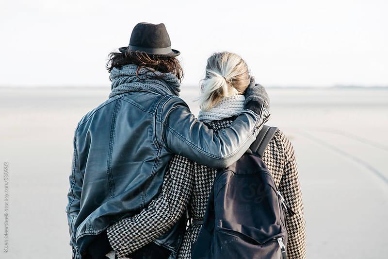 Couple in love embraced on the beach. by Koen Meershoek for Stocksy United