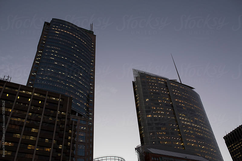 Sydney skyscrapers at dusk by Reece McMillan for Stocksy United