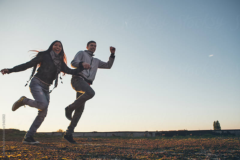 Couple Running by Lumina for Stocksy United