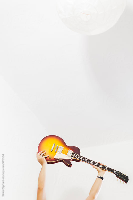 Raised guitars by Silvia Cipriani for Stocksy United