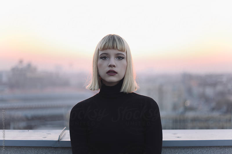 Portrait of a beautiful blonde woman outdoors during sunset by VeaVea for Stocksy United