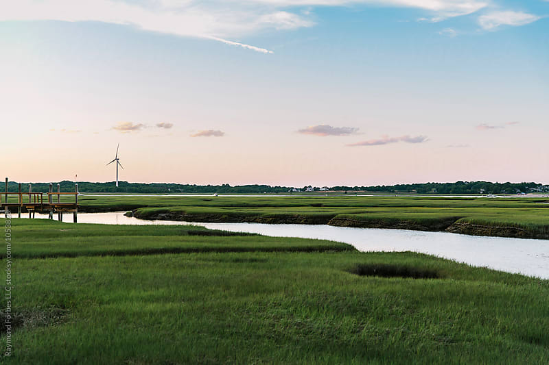 Wind Turbine in Marsh Landscape by Raymond Forbes LLC for Stocksy United
