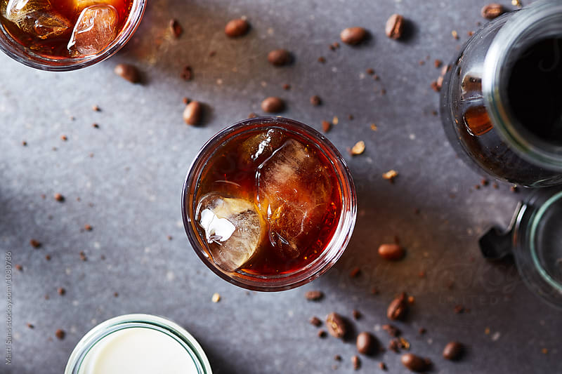 Glass of ice brew coffee with milk by Martí Sans for Stocksy United