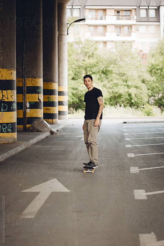 Young Man Skateboarding in the Streets by Ani Dimi for Stocksy United