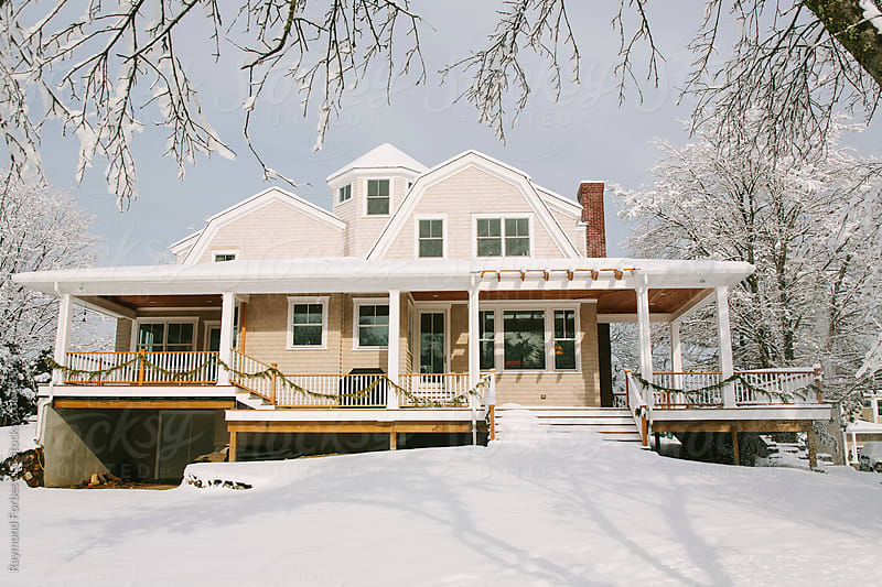 Exterior of house in Winter by Raymond Forbes LLC for Stocksy United