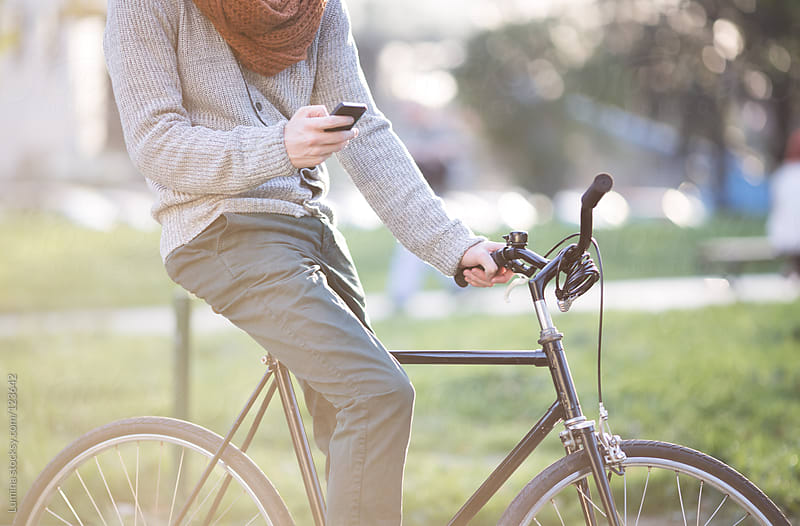 Man Texting on the Bicycle by Lumina for Stocksy United