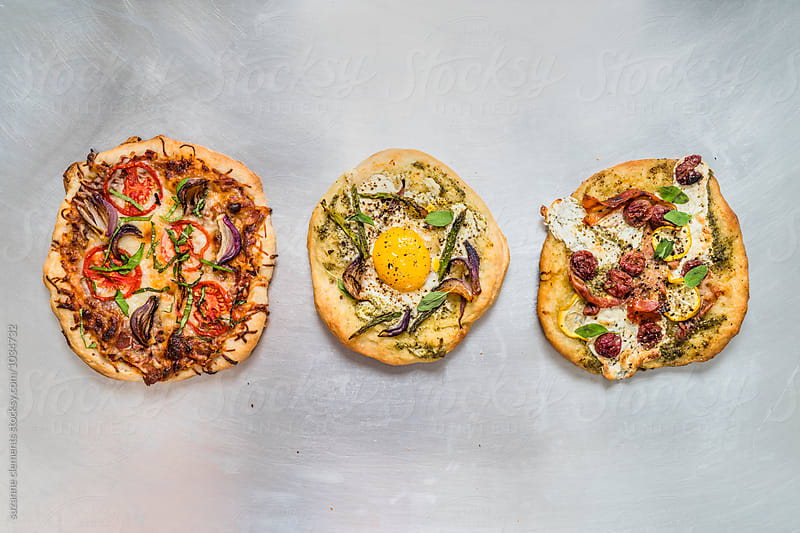 Trio of Rustic Pizzas by suzanne clements for Stocksy United