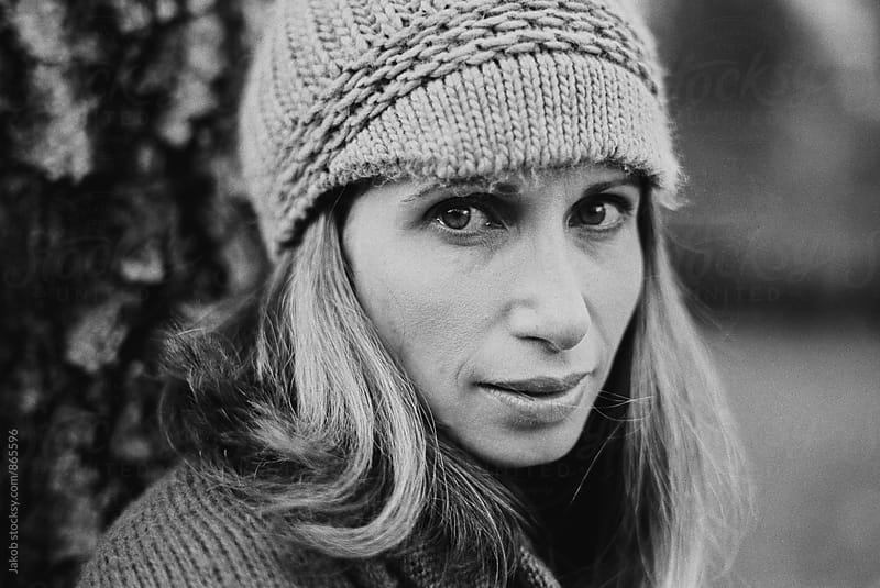 Black and white portrait of a beautiful woman in a beanie by Jakob for Stocksy United