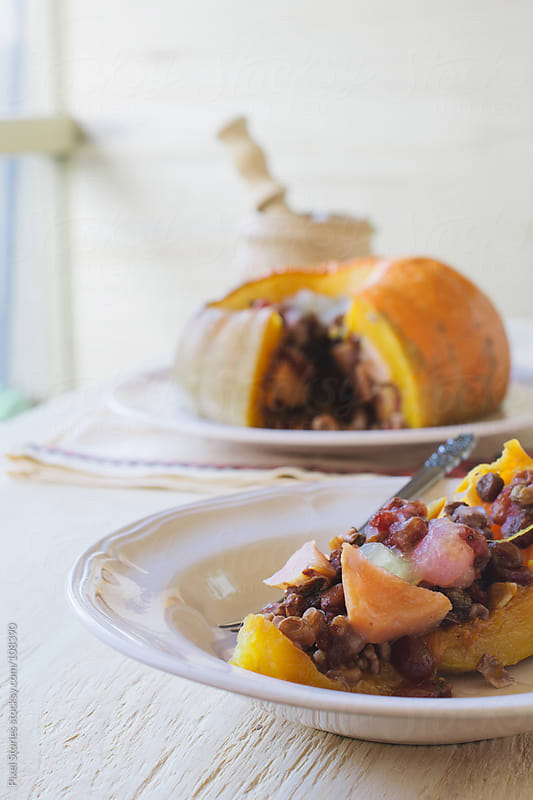 Roasted stuffed pumpkin by Pixel Stories for Stocksy United