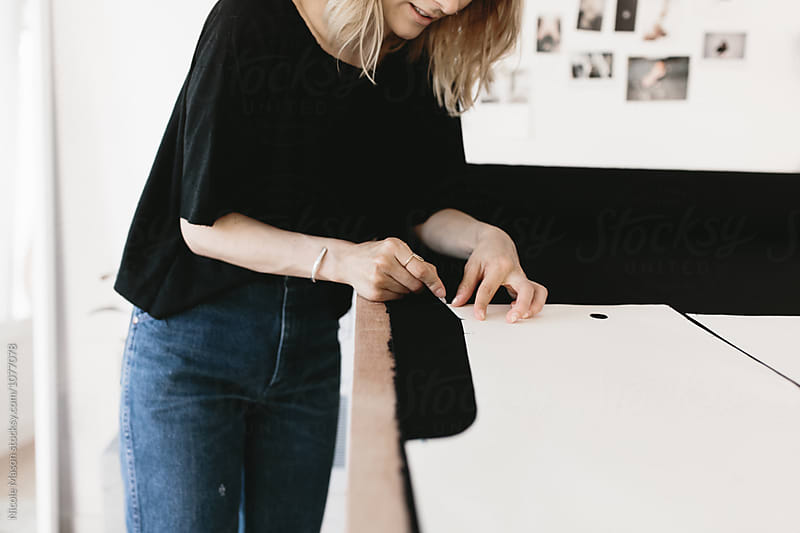 young artist woman designing clothing in studio by Nicole Mason for Stocksy United