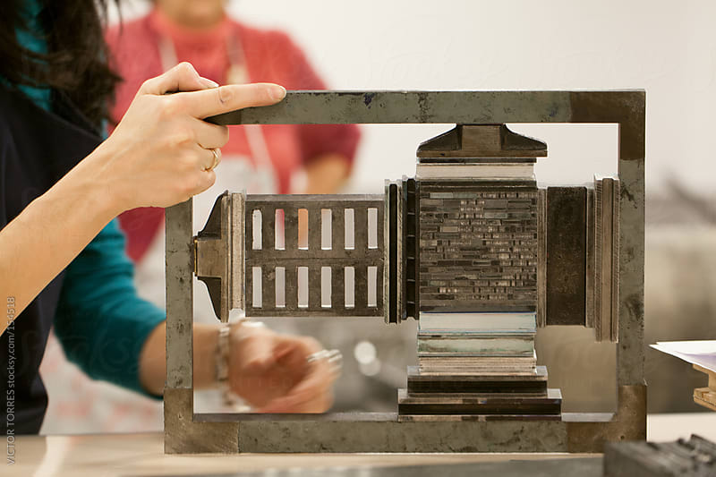 Woman Working with Lead Press Types by VICTOR TORRES for Stocksy United