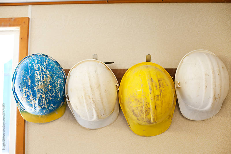 Safety hardhats hanging up. by Hugh Sitton for Stocksy United
