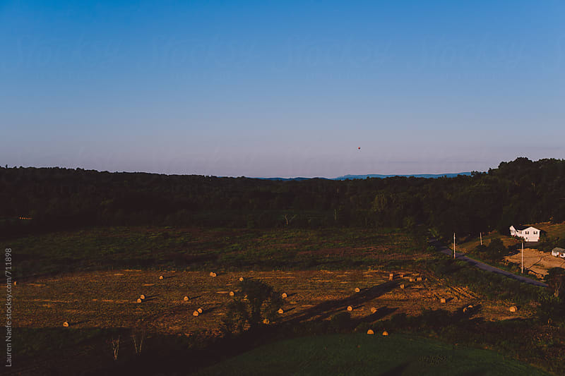 Countryside during sunrise by Lauren Naefe for Stocksy United