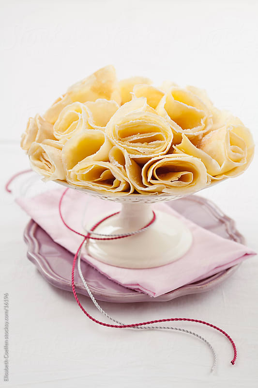 Crepes rolled up and arranged on a cake stand by Elisabeth Coelfen for Stocksy United
