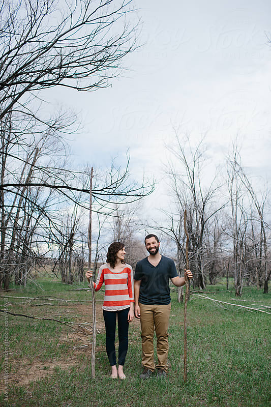 Couple with Sticks by luke + mallory leasure for Stocksy United
