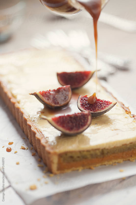 Pistachio-apricot-fig tart by Csenge Dusha for Stocksy United