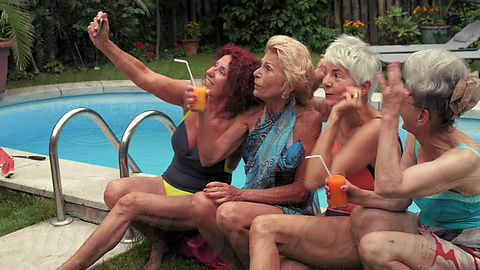 53d819507da22 4 Mature women taking a selfie by the pool on a Summer day by Beatrix Boros