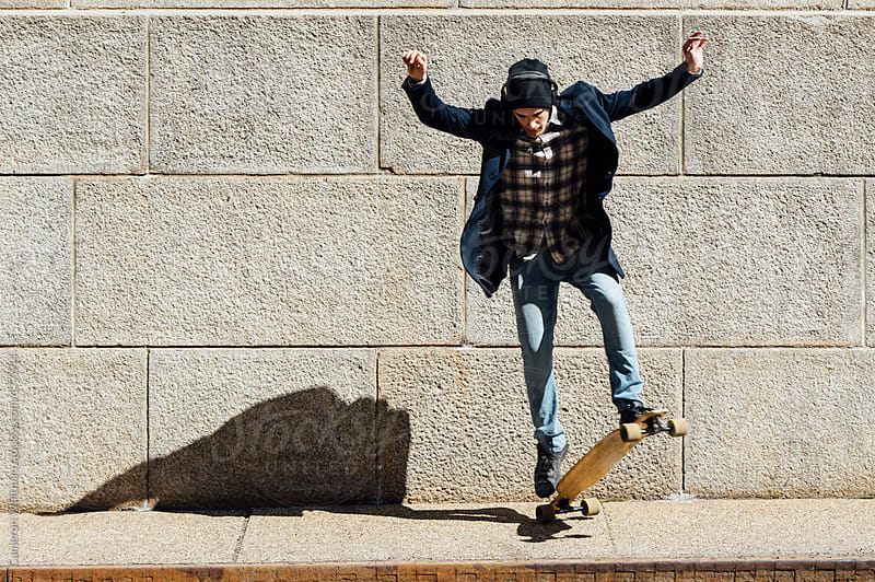 Longboard Ollie by Cameron Whitman for Stocksy United