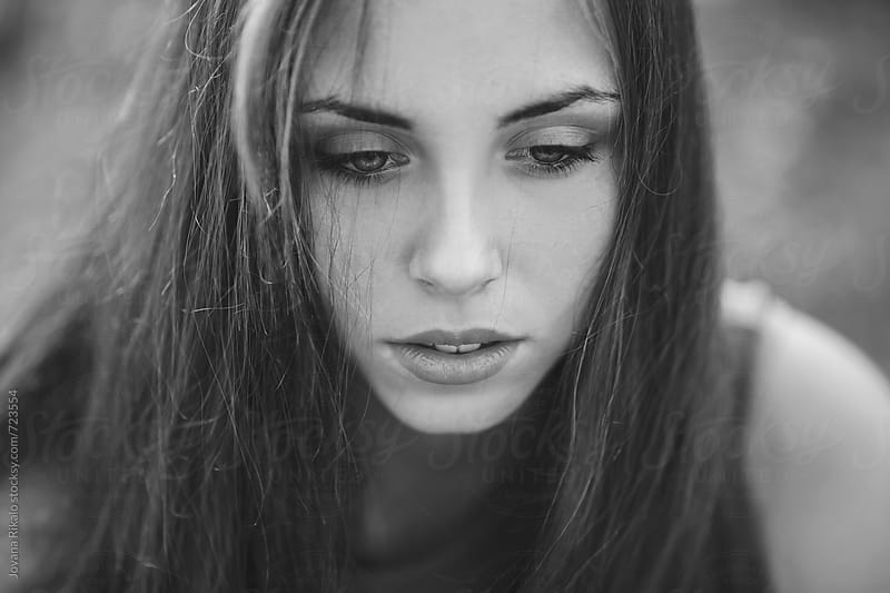 Black and white portrait of a beautiful young woman by Jovana Rikalo for Stocksy United
