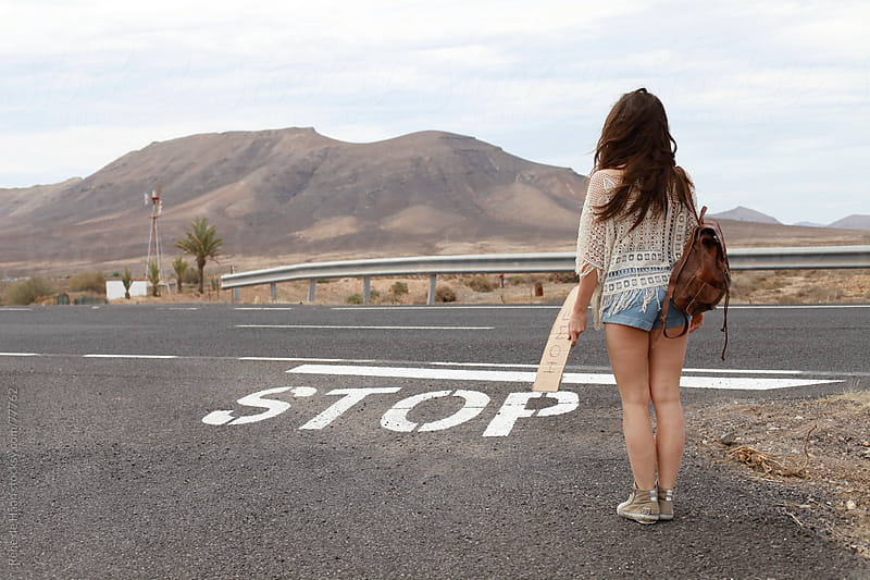 girl hitch-hiking by Rene de Haan for Stocksy United
