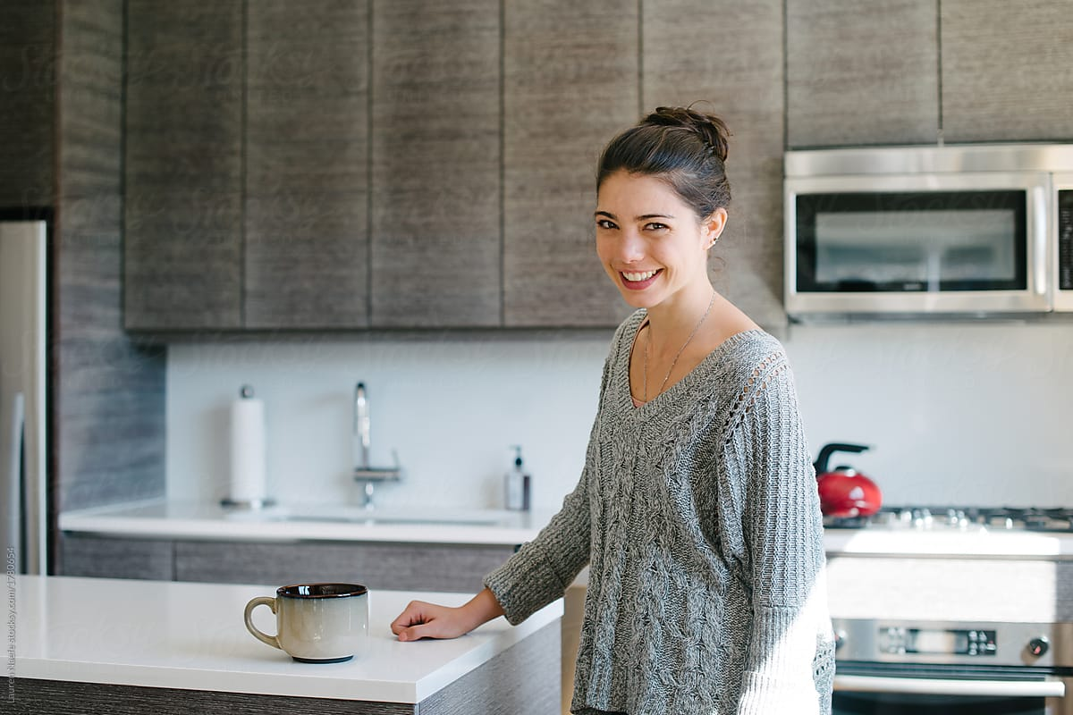 Young Woman Smiling In Kitchen By Lauren Naefe Stocksy United