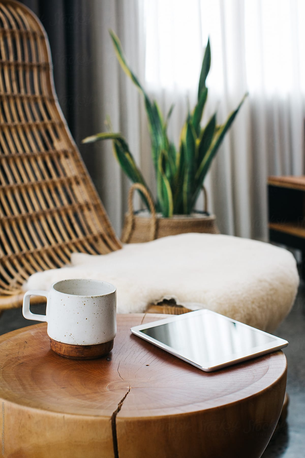 Digital Tablet And Ceramic Mug Standing On Coffee Table In Stylish Living  Room by VISUALSPECTRUM - Mug, Tablet