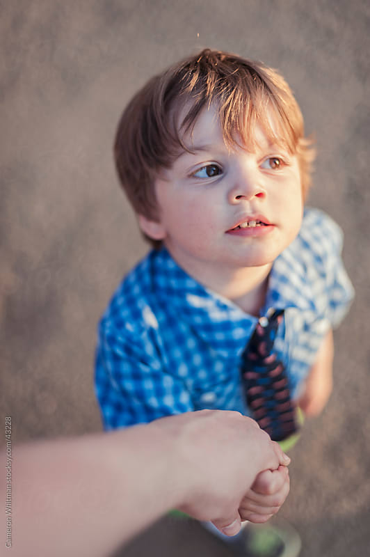 Little Boy Holding Daddy's Hand by Cameron Whitman for Stocksy United
