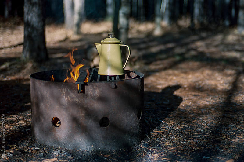 An enamel kettle on a campfire by Riley J.B. for Stocksy United