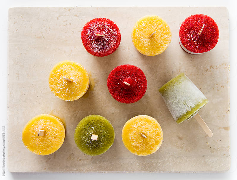 Homemade ice pops on marble cutting board by Pixel Stories for Stocksy United