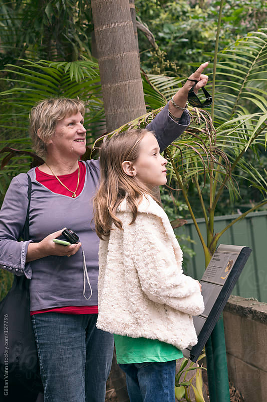 granny spotting animals at the zoo by Gillian Vann for Stocksy United