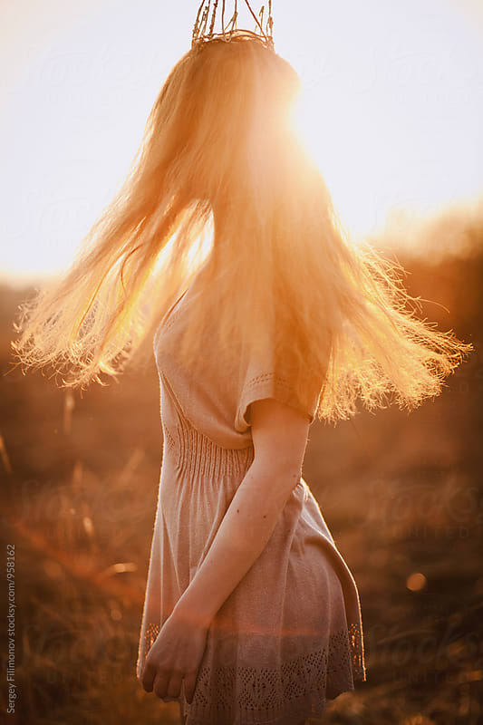 Beautiful red hair fluttering in the sunset by Sergey Filimonov for Stocksy United