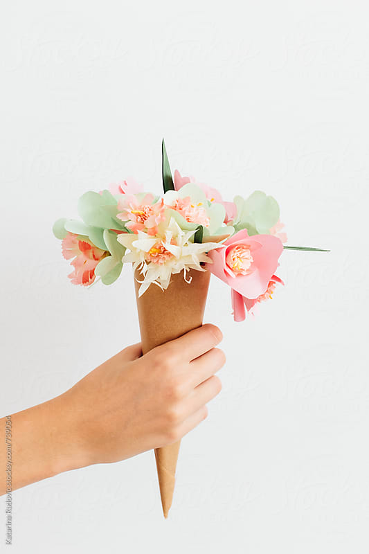 Female Hand Holding Paper Flowers Bouquette by Katarina Radovic for Stocksy United
