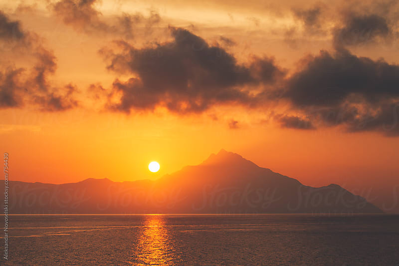 Beautiful sunrise above Athos by Aleksandar Novoselski for Stocksy United