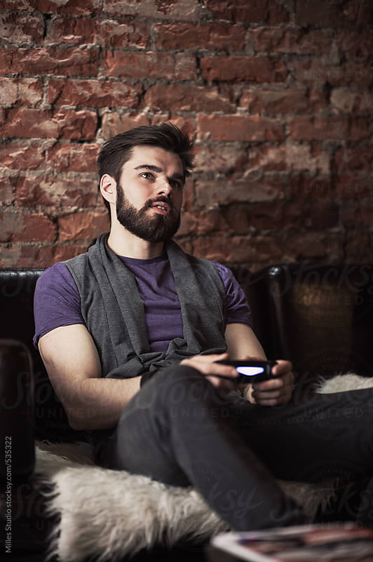 Man Playing Videogames with Gamepad by Milles Studio for Stocksy United