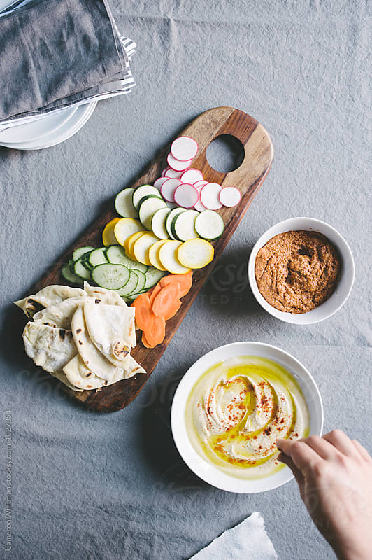 Mediterranean Dips with Homemade Grilled Pita Bread by Cameron Whitman for Stocksy United