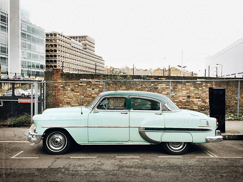 An old american car parked on a street by James Ross for Stocksy United