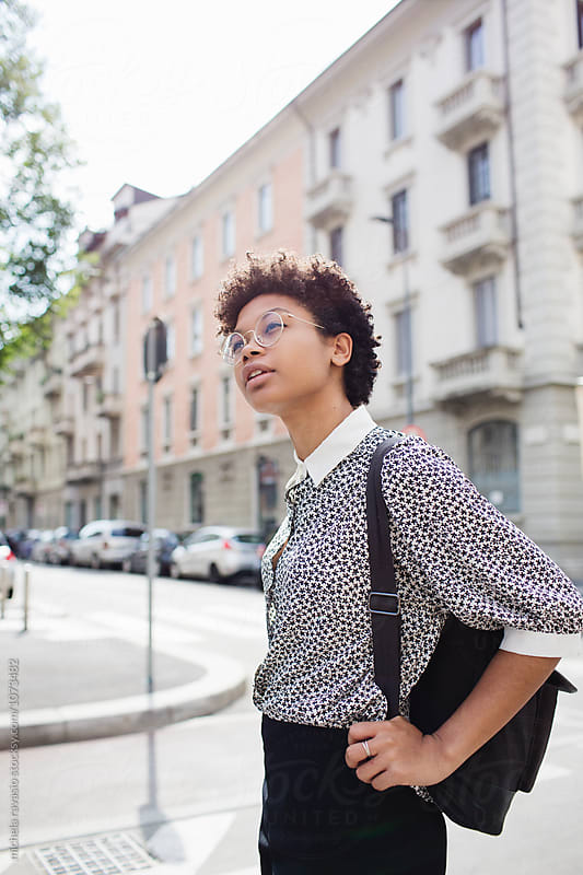 Woman walking around the city by michela ravasio for Stocksy United