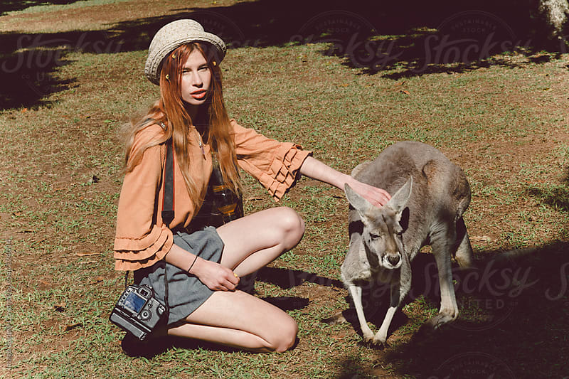 girl petting kangaroo by Image Supply Co for Stocksy United