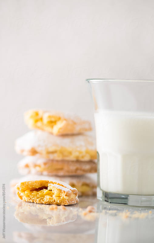 Italian Lemon Filled Cookies and Milk by Jeff Wasserman for Stocksy United
